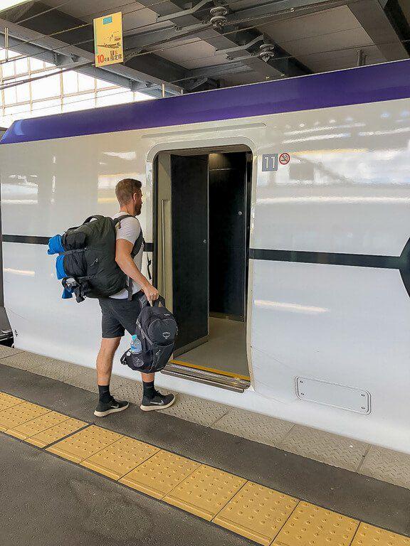 Mark boarding a bullet train in Japan