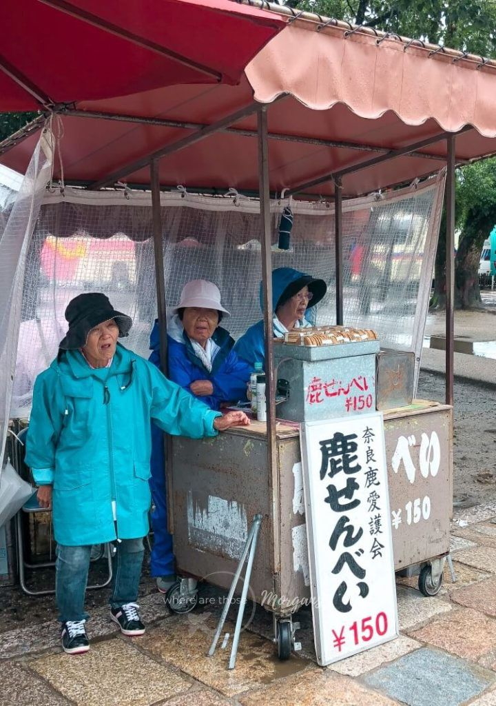 Three ladies selling deer crackers to tourists