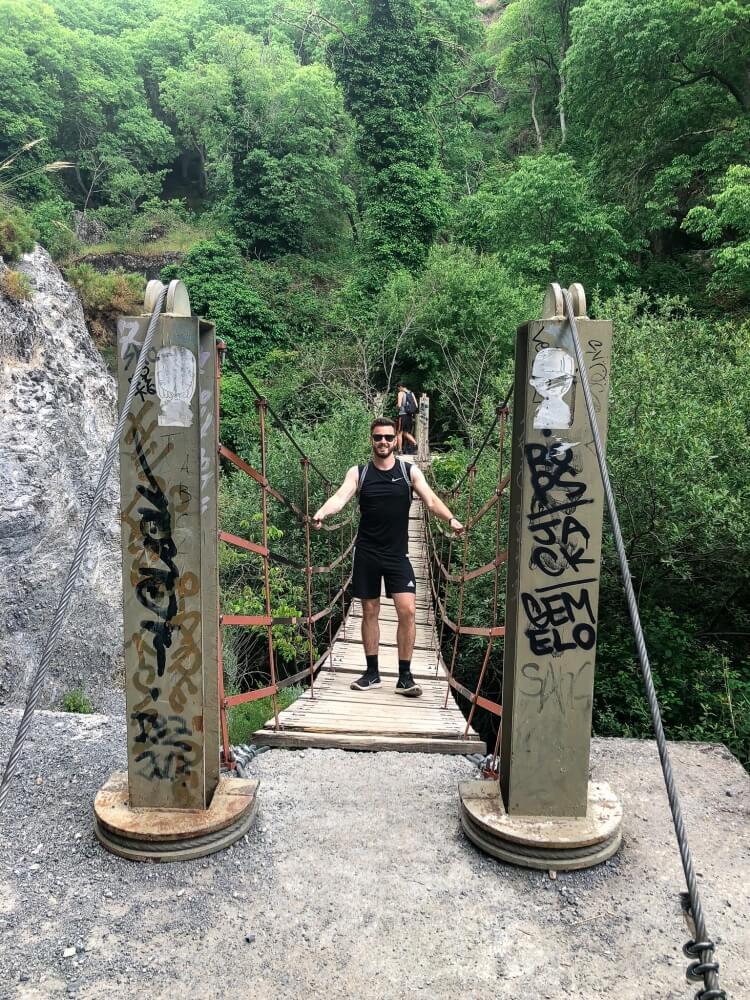 Mark standing on hanging bridge in Sierra Nevada
