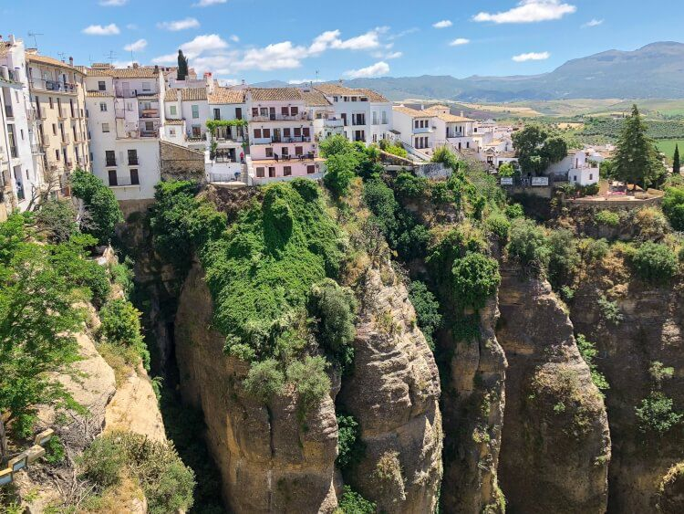 amazing view of buildings along the edge of a mountain