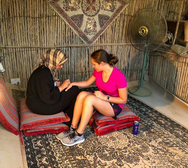 Kristen getting a henna tattoo during a Dubai safari