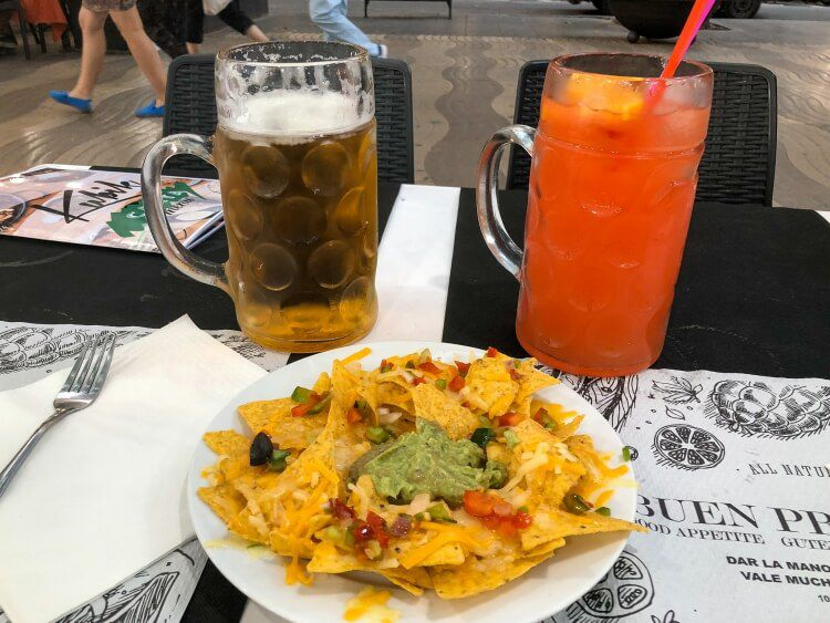 2L drink and nachos appetizer on La Rambla