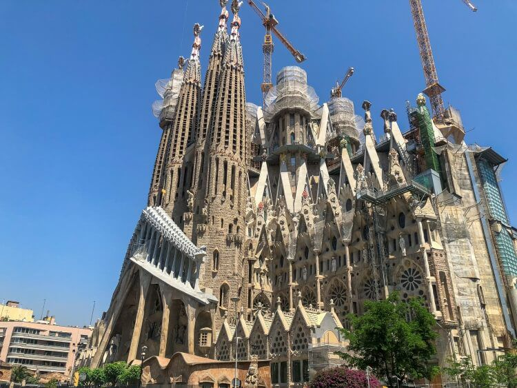 Sagrada Familia with cranes for construction during a weekend in Barcelona