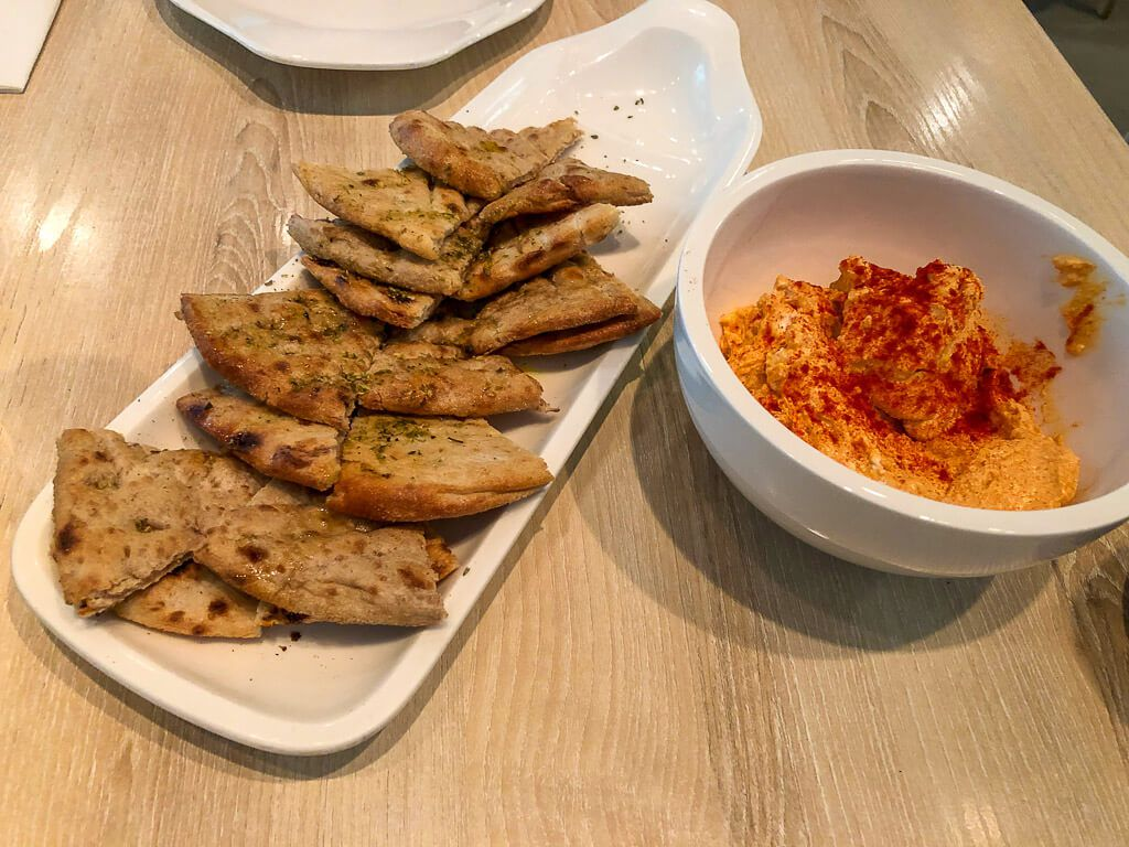 Pita bread and red pepper hummus