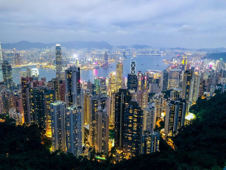 Victoria Peak Hong Kong in dusk as building begin to light up