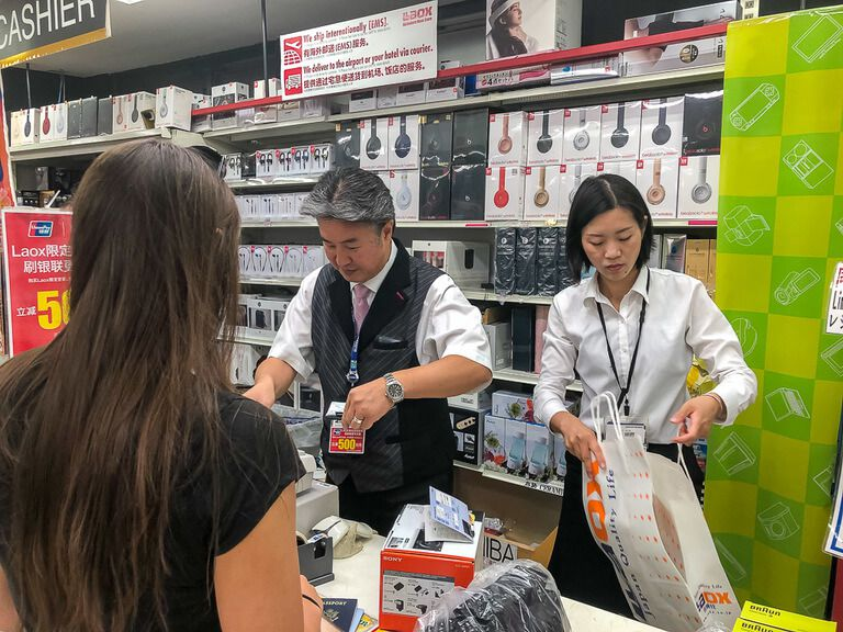 kristen buying our first ever camera in tokyo Japan