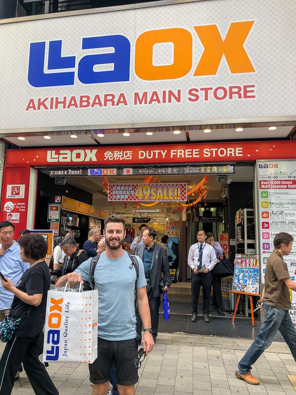 Mark outside LAOX with brand new camera in bag