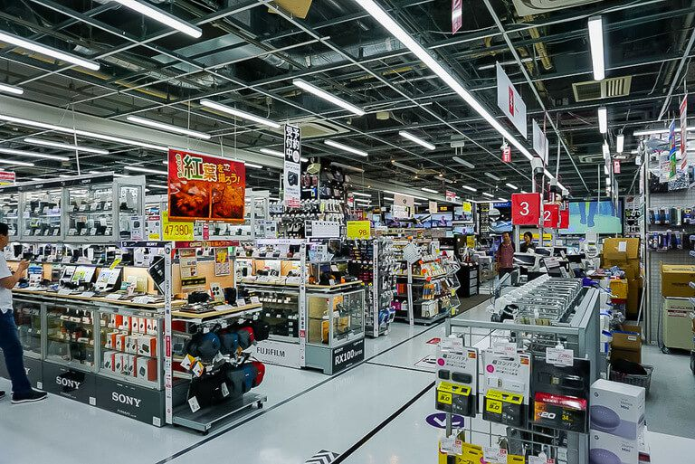 typical shop floor in tokyo buying a camera