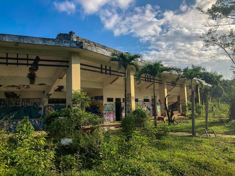 Exterior of abandoned water park amphitheater hue