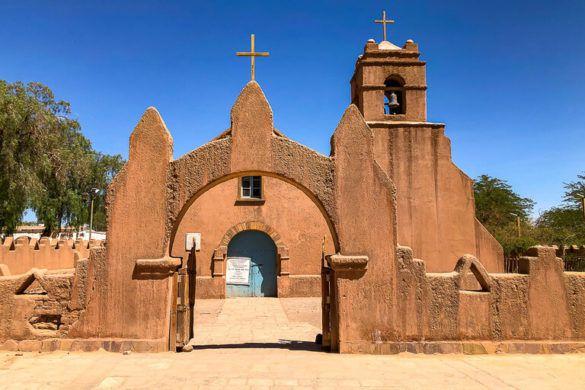 orange clay church with brilliant blue sky in San Pedro de atacama town