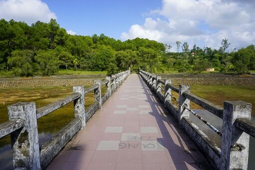 Narrow bridge leading from dragon to the side of lake