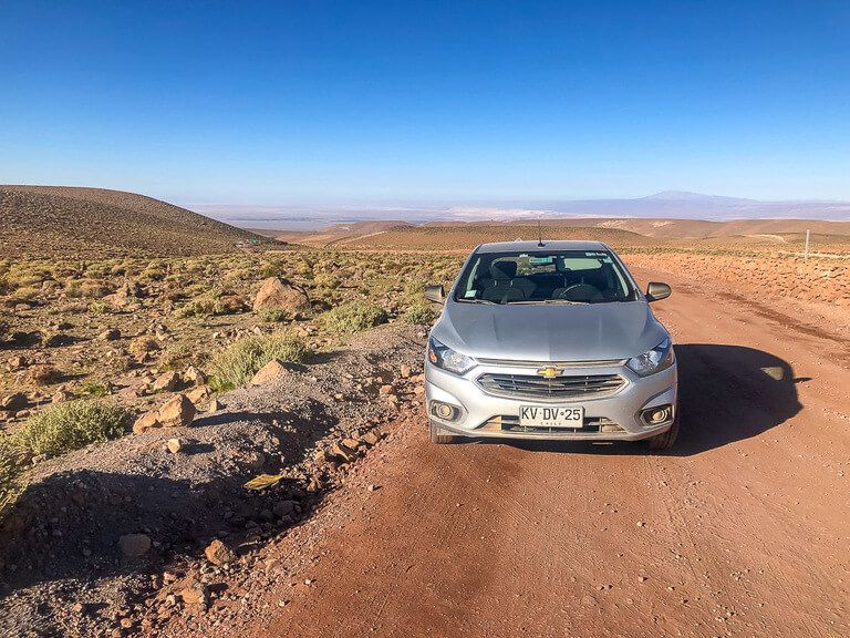 hire car on dirt road with open views on itinerary for San Pedro de atacama
