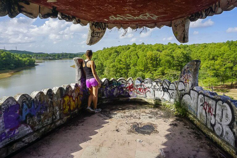 Kristen looking out of a dragons mouth at a lake in hue