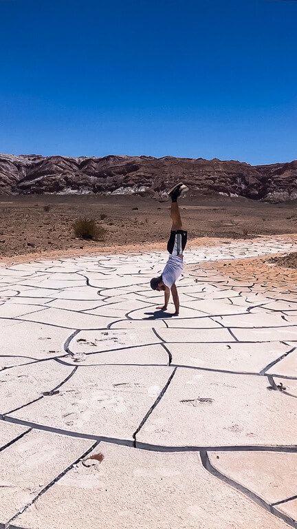 mark trying a handstand on cracked salt mud in atacama