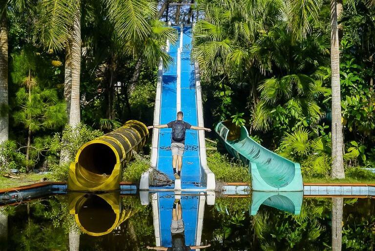 Mark balancing between two water slides at the abandoned park in hue