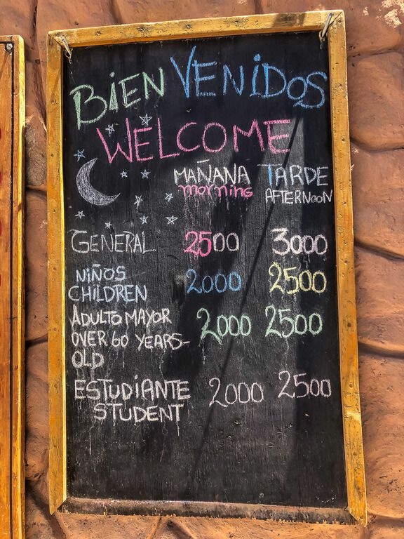 sign of all prices for entrance to valle de la luna by mountain bike