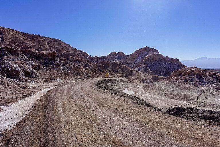 dirt road in Valle de la luna bending through rocky terrain