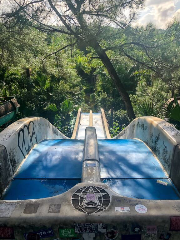 Blue water slide from the top at abandoned park hue