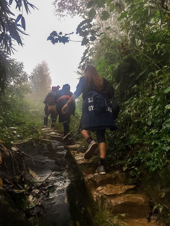 Kristen walking up stone steps in sapa vietnam 3 day itinerary