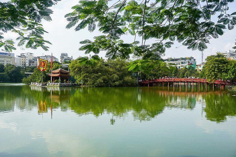Bridge of rising sun to jade island and Ngoc son pagoda Hoan Kiem lake Vietnam