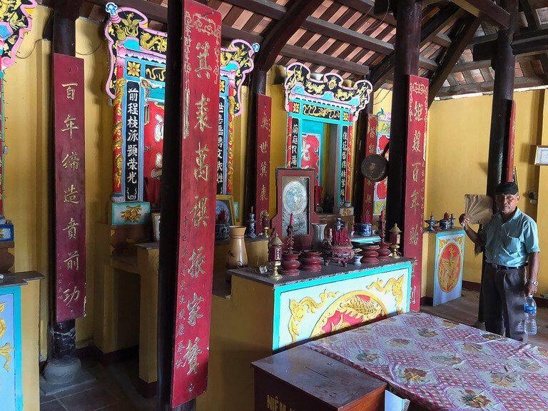 Man in family temple Vietnam