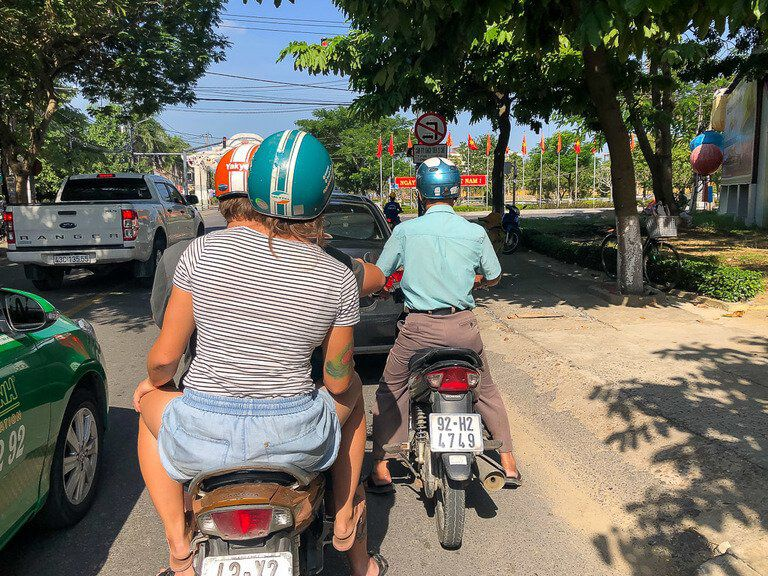 Motorbikes and cars on road in vietnam