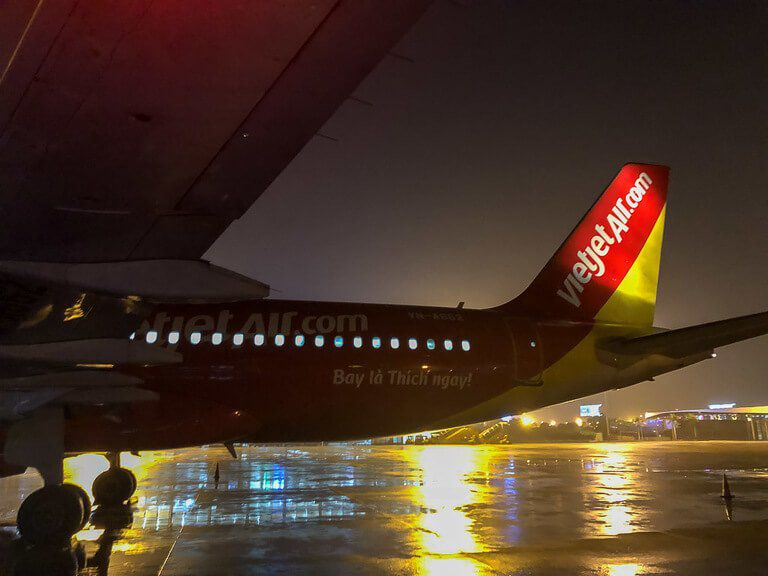 VietJet Air plane on Hanoi tarmac yellow and red paint at night
