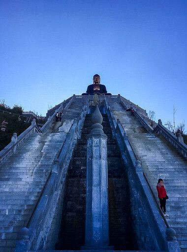 Gorgeous symmetrical staircases flanking each side of buddha statue Fansipan vietnam