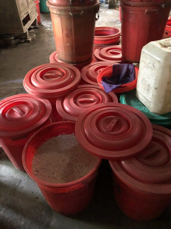 Red barrels filled with rice wine