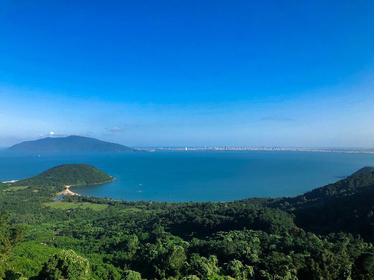 Da nang city across blue water from Hai Van pass on way to Hoi An vietnam