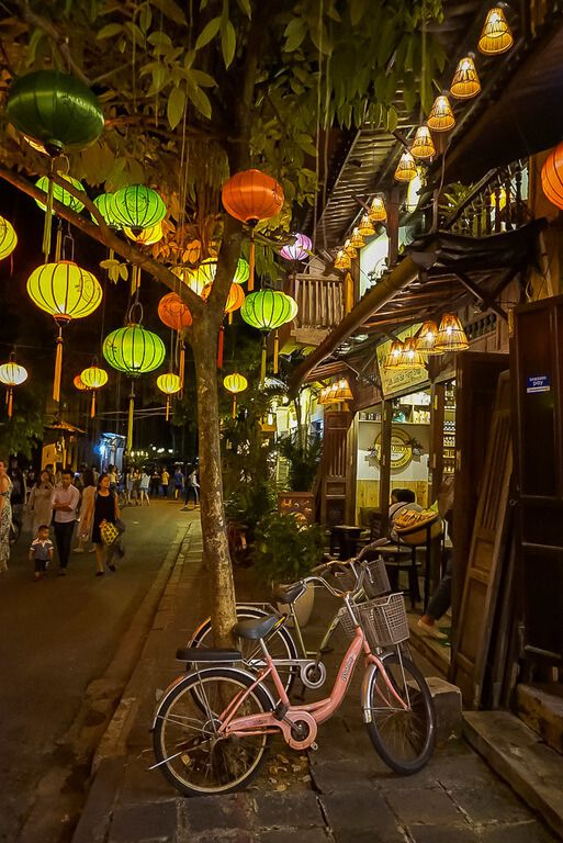 Hoi An ancient town lanterns and pink bicycle