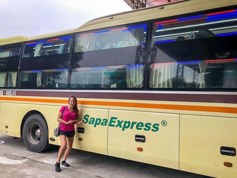 Kristen smiling next to the Sapa Express bus Vietnam