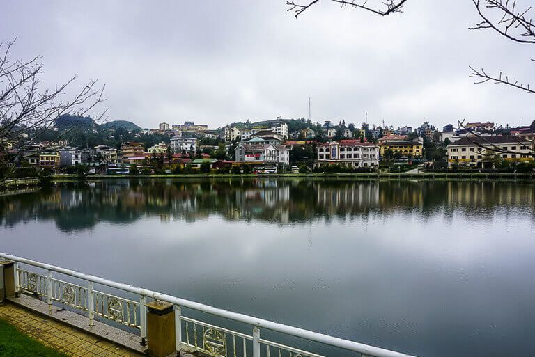 Lake in downtown Sapa Vietnam with reflecting houses on far side
