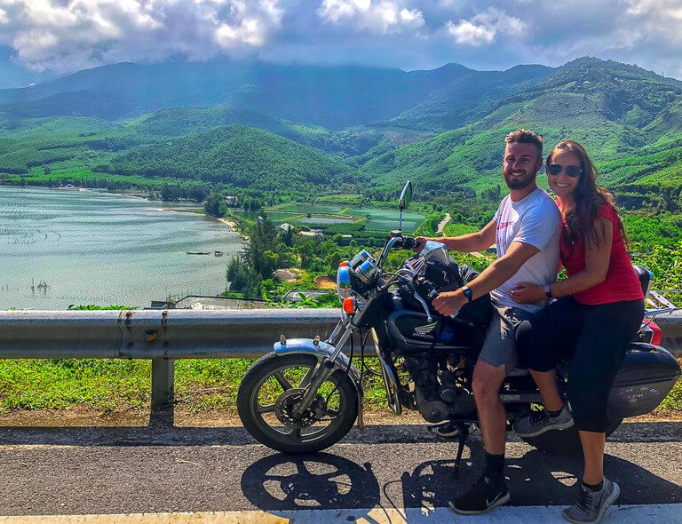 Mark and kristen on a motorbike crossing Hai Van pass near da nang on way to Hoi An