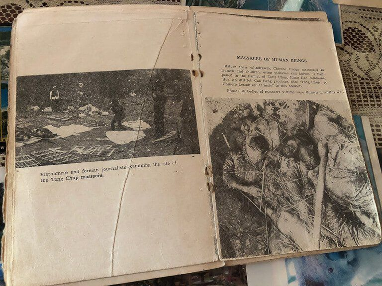 very old book depicting a massacre in vietnam