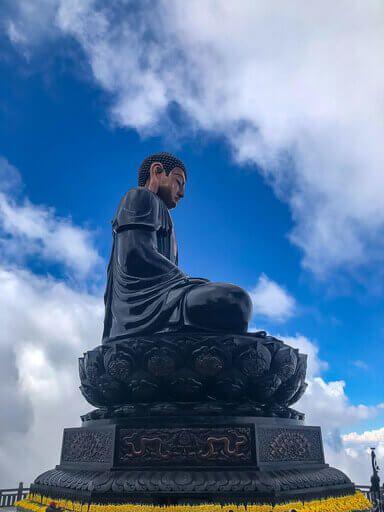 Statue of a huge black buddha on Fansipan mountain sapa itinerary vietnam
