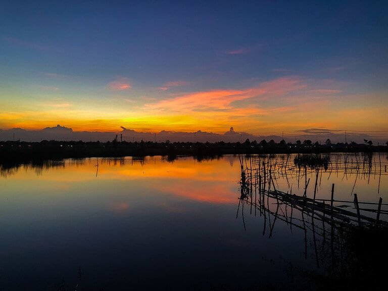 sunset in Hoi An after arriving from da nang gorgeous yellows and oranges in sky