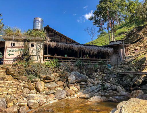wooden restaurant next to waterfall sapa valley Vietnam