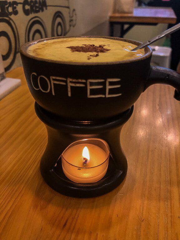 Egg coffee in vietnam with candle below mug