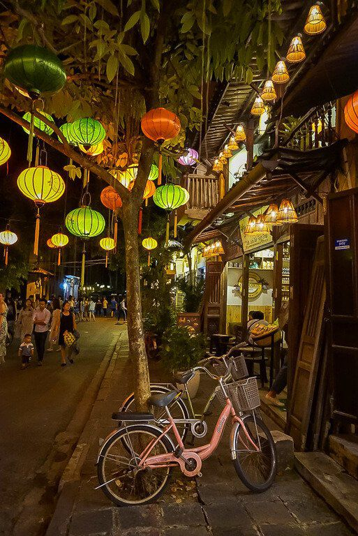 Hoi an at night with lanterns and pink bike against tree lovely atmosphere