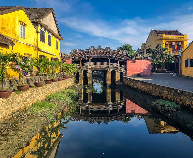 Hoi An Japanese bridge colorful and reflecting on water seventh stop on 3 week Vietnam Itinerary