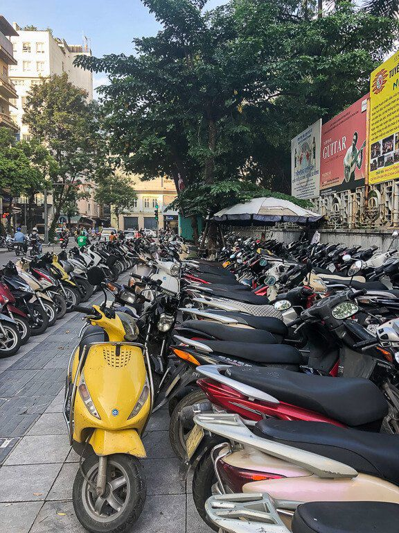 One things to know about Vietnam is that motorbikes are life sidewalk packed full of scooters