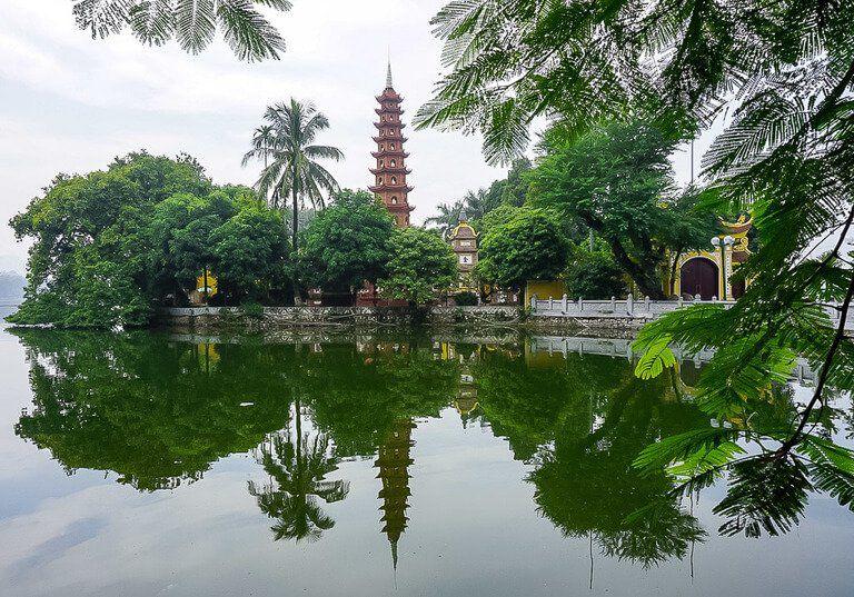 pagoda and reflection in lake in Hanoi Vietnam