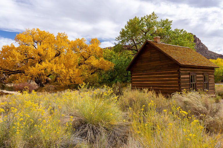 Fruita schoolhouse communal building park ranger talks surrounded by colorful trees in Capitol Reef national park