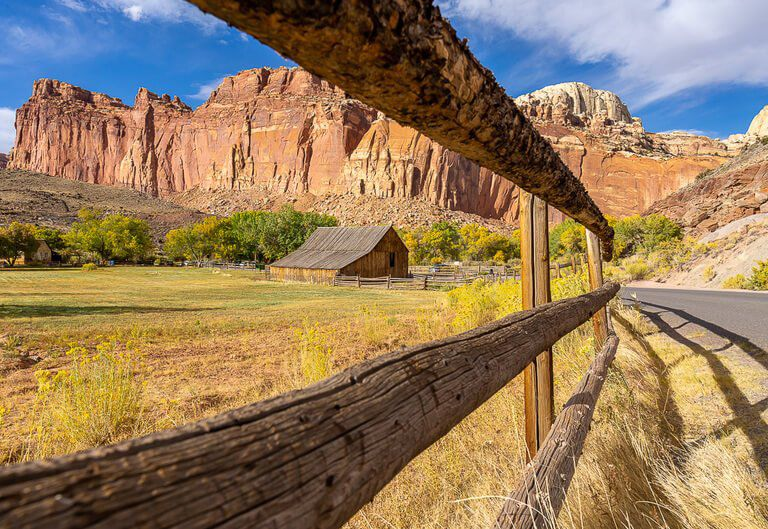 fruita barn on Gifford homestead at Capitol Reef national park through fence view