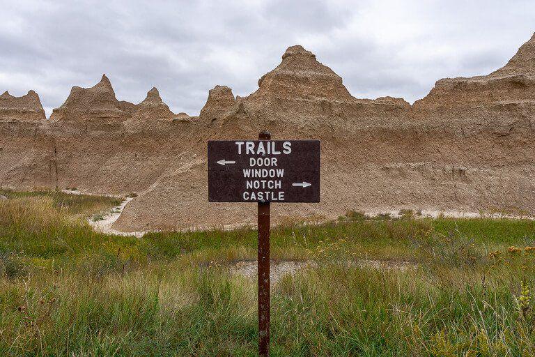 Badlands signpost listing all hiking trails