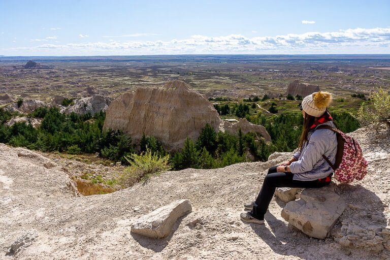 Kristen at the end of notch trail enjoying the badlands view