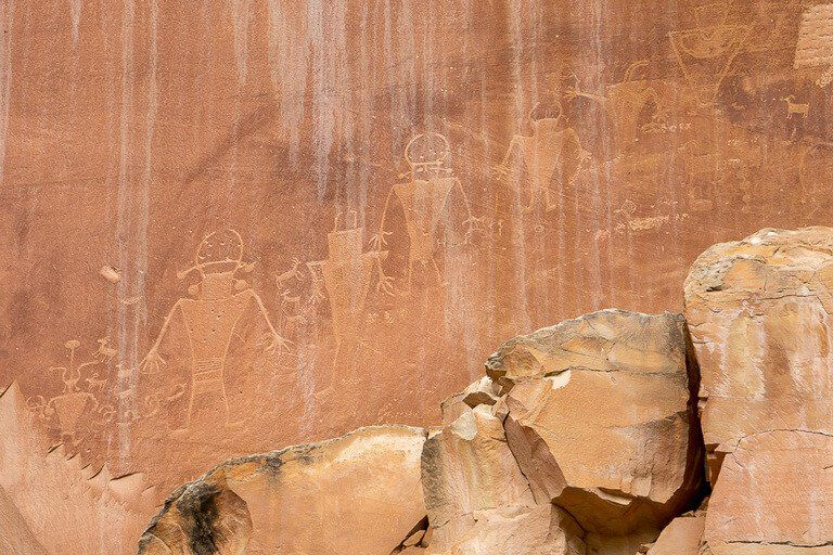 Fremont petroglyphs carved into a rock face in Capitol Reef national park