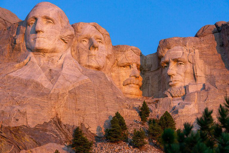 Mount Rushmore vacation guide sunrise over the presidents faces