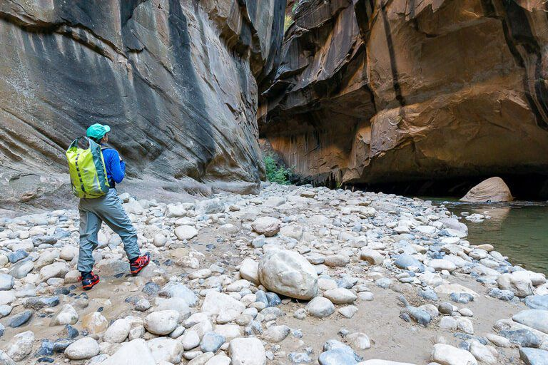 Kristen walking the narrows Zion included with national park pass
